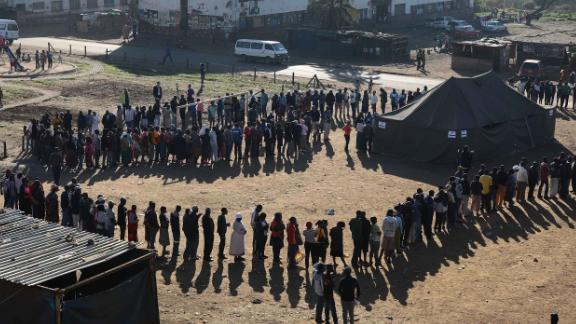 Voters queue at a polling station in Harare.