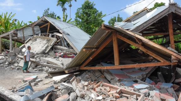 An Indonesian man examines the remains of houses, after a 6.4 magnitude earthquake struck, in Lombok on July 29.