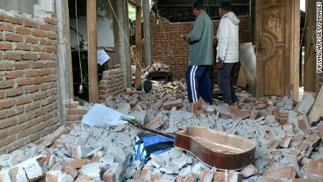 Villagers go through a house that was damaged after a magnitude 6.4 earthquake in Lombok on July 29.