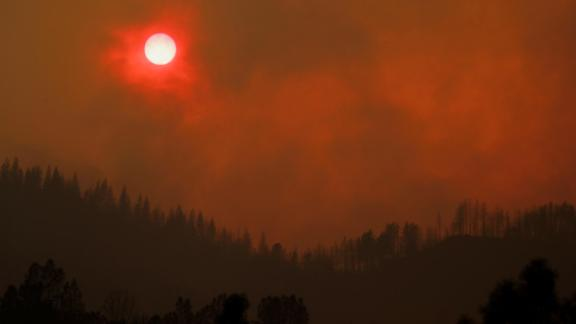 The setting sun is turned red by smoke from the Carr Fire on Friday, July 27.