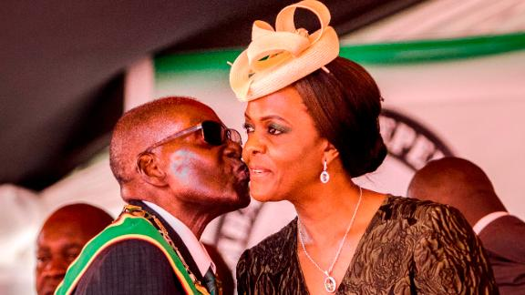 President Robert Mugabe kisses his wife and first lady Grace Mugabe during during the country