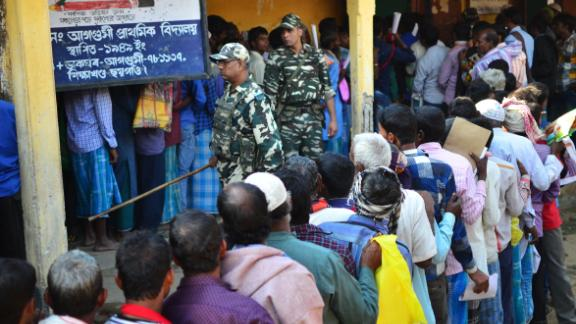 People stand in line to check their names on the first draft of the National Register of Citizens (NRC) at Gumi village of Kamrup district in the Indian state of Assam on January 1, 2018.