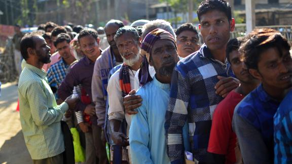 Assam is the only state in India to have a citizenship register. Villagers in Assam stand in line to check their names on the first draft of NRC in 2018.