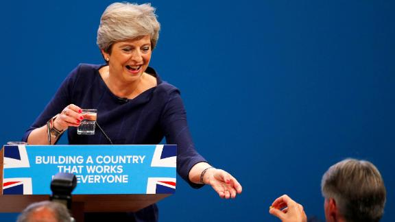 Theresa May accepted a cough sweet during a speech in 2017.