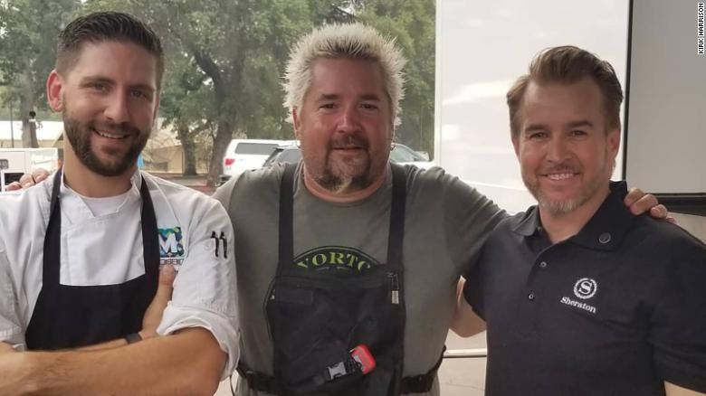 Guy Fieri (center) and Harrison (right) at an event that provided food for families displaced by the fire.