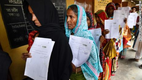 Residents hold their documents as they stand in a queue to check their names on the final list of National Register of Citizens (NRC) at a NRC Sewa Kendra (NSK) in Burgoan village in Morigoan district on July 30, 2018. - India on July 30 stripped four million people of citizenship in the northeastern state of Assam, under a draft list that has sparked fears of deportation of largely Bengali-speaking Muslims. Critics say it is the latest move by right-wing Prime Minister Narendra Modi to advance the rights of India's Hindu majority at the expense of its many minorities, in particular its over 170 million Muslims. (Photo by Biju BORO / AFP)        (Photo credit should read BIJU BORO/AFP/Getty Images)
