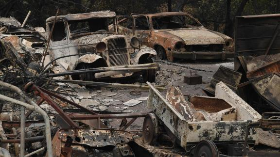 The Carr Fire leaves cars destroyed near Redding on July 31.