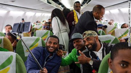 Passengers pose for a selfie inside an Ethiopian Airlines flight from Addis Ababa, Ethiopia, to Eritrea's capital Asmara on July 18. It was the first commercial flight from Ethiopia to Eritrea in two decades.