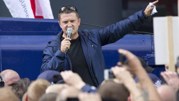 Leader of the right-wing EDL (English Defence League) Tommy Robinson (C) aka Stephen Yaxley-Lennon speaks to his followers at a protest in central London on September 7, 2013.  Members of the EDL assembled in central London despite losing a high court battle to demonstrate in the Tower Hamlets area of East London, which they claim is subjected to Sharia Law.  AFP PHOTO / JUSTIN TALLIS        (Photo credit should read JUSTIN TALLIS/AFP/Getty Images)