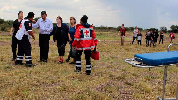 Red Cross workers tend to survivors of the plane crash Tuesday.