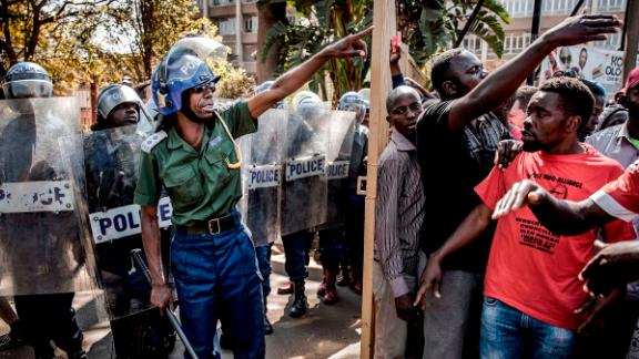 Zimbabwean anti-riot police officers close the entrance to the Rainbow Towers where the election's results were announced.