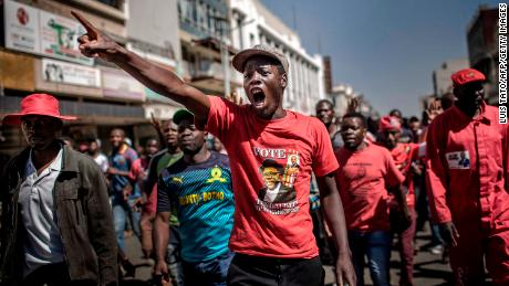 Supporters of the opposition party Movement for Democratic Change (MDC) protest against alleged widespread fraud by the election authority and ruling party.
