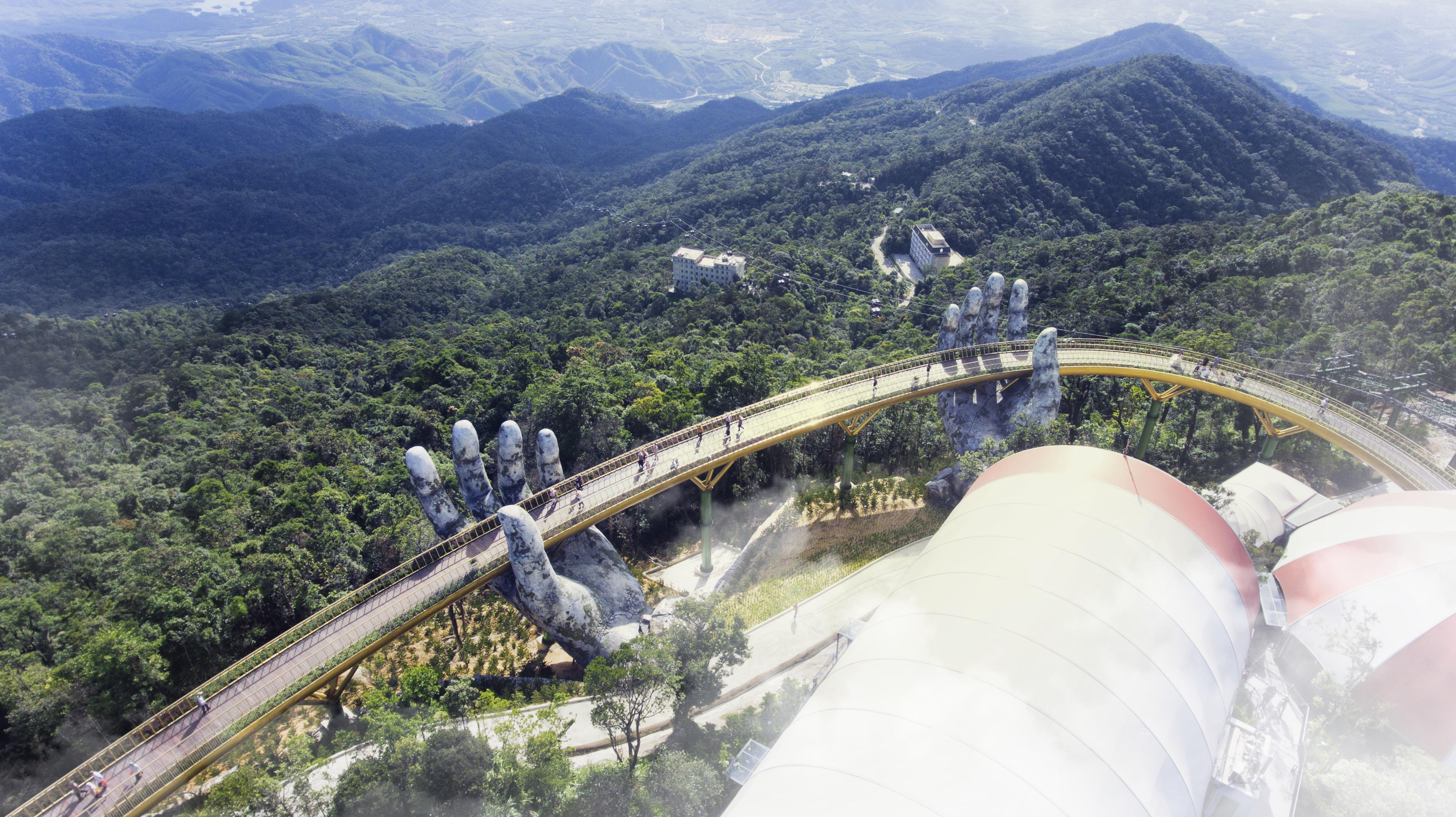 51aef0cf4 Giant hands cradle new bridge in Vietnam - CNN Video