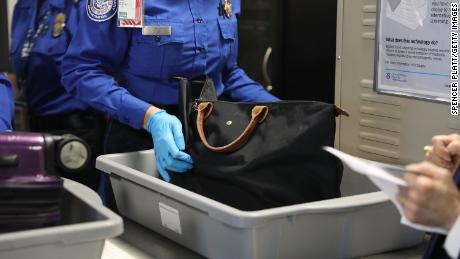A Transportation Security Administration (TSA) worker screens luggage at LaGuardia Airport (LGA) on September 26, 2017 in New York City.