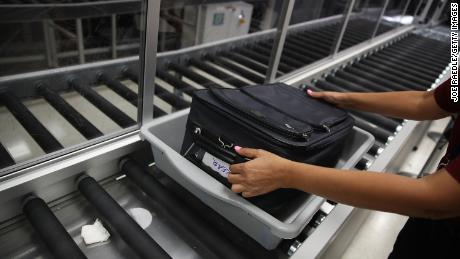 A bag is cleared through an automated screening lane funded by American Airlines and installed by the Transportation Security Administration at Miami International Airport on October 24, 2017 in Miami, Florida.