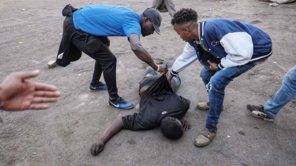 A man lies on the ground after the Zimbabwean army opened fire in central Harare on Wednesday.