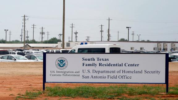 FILE - In this June 30, 2015, file photo, signs are seen at the entrance to the South Texas Family Residential Center in Dilley, Texas. The Justice Department says it will temporarily transfer immigration judges to six detention centers near the border with Mexico in an effort to put President Donald Trump's immigration directives into effect.  (AP Photo/Eric Gay, File)