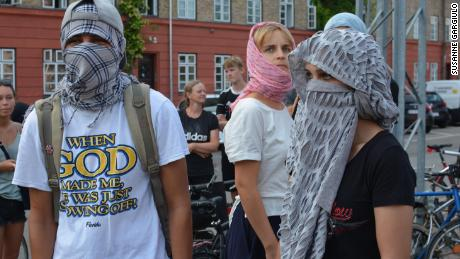 Demonstrators wear face veils to protest Denmark's burqa ban.