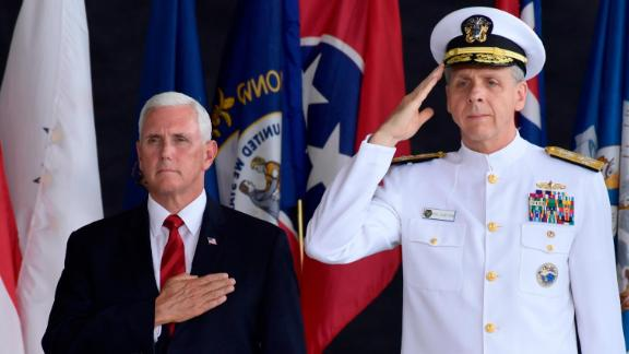 Vice President Mike Pence attends a ceremony wit Commander of U.S. Indo-Pacific Command Adm. Phil Davidson marking the arrival of the remains believed to be of American service members who fell in the Korean War at Joint Base Pearl Harbor-Hickam, Hawaii, Wednesday, Aug. 1, 2018. (AP Photo/Susan Walsh)