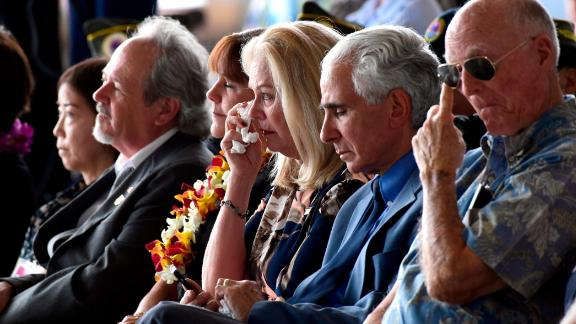 People listen at a ceremony marking the arrival of the remains believed to be of American service members killed in the Korean War at Joint Base Pearl Harbor-Hickam in Hawaii.