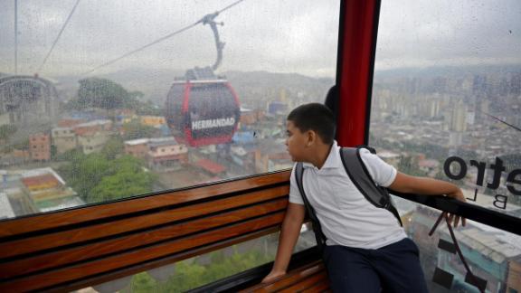 Venezuelan child Leobardo Medina, 8, goes to school in Caracas, on June 20, 2013. Leo Ramirez/AFP/Getty Images