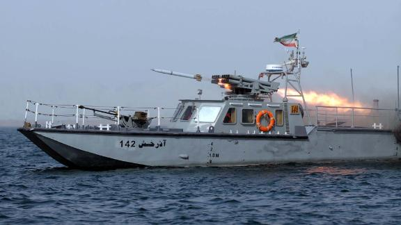 "An Iranian war-boat fires a missile during the ""Velayat-90"" navy exercises in the Strait of Hormuz in southern Iran on December 30, 2011. Iran, which has been carrying out war games in the Strait of Hormuz over the past week, has said that ""not a drop of oil"" would pass through the strait if Western governments follow through with planned additional sanctions over its nuclear programme.  AFP PHOTO/IIPA/ALI MOHAMMADI (Photo credit should read ALI MOHAMMADI/AFP/Getty Images)"