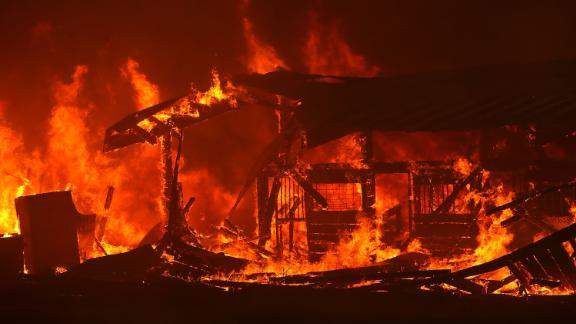 A barn burns on Tuesday, July 31, as the River Fire moves through Lakeport.