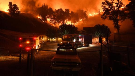 Firefighters conduct a controlled burn to defend houses from the Ranch Fire as it moves toward Upper Lake.