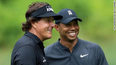 Phil Mickelson (left) and Tiger Woods played a practice round together at Firestone Country Club.