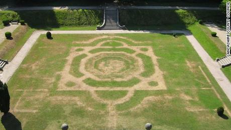 This summer's heatwave has revealed the layout of a long-lost garden at Gawthorpe Hall in Lancashire, England.