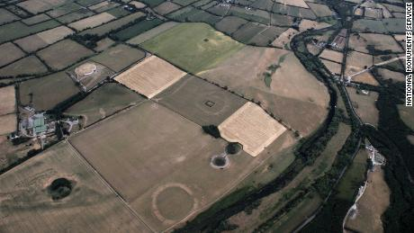 Yellowing fields in Ireland have exposed markings of prehistoric ruins along the River Boyne.