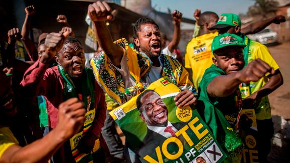 Supporters celebrate after Mnangagwa is declared the winner in Zimbabwe's landmark election.