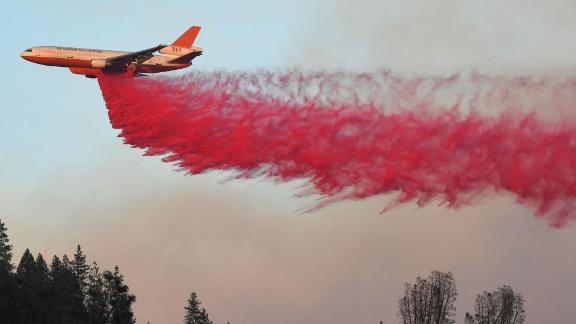An air tanker drops fire retardant near Redding on August 2.