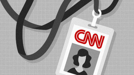 A CNN press badge and lanyard
