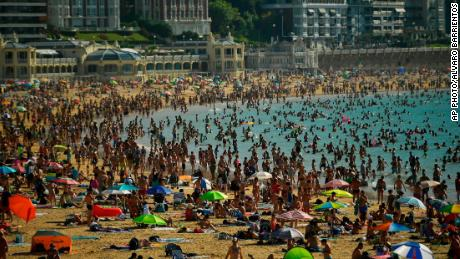 People crowd La Concha beach Friday in the Basque city of San Sebastian in northern Spain.
