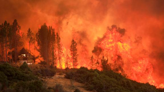 Flames from a wildfire move up a ridge near Lakeport on August 2.