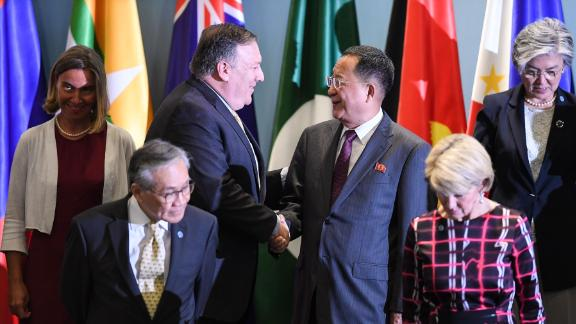 US Secretary of State Mike Pompeo (3rd L) shakes hands with North Korea's Foreign Minister Ri Yong Ho (3rd R) as they arrive for a group photo at the ASEAN Regional Forum Retreat during the 51st Association of Southeast Asian Nations (ASEAN) Ministerial Meeting (AMM) in Singapore on August 4, 2018. - Leaders, ministers and representatives are meeting in the city-state from August 1 to 4 for the ASEAN Ministerial Meeting (AMM). (Photo by Mohd RASFAN / AFP)        (Photo credit should read MOHD RASFAN/AFP/Getty Images)