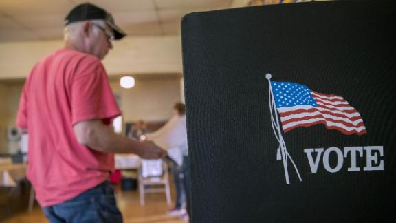 A voter arrives at a booth to fill out ballot at a polling location during the primary election in Lebanon Church, Virginia, U.S., on Tuesday, June 12, 2018. In the Shenandoah Valley