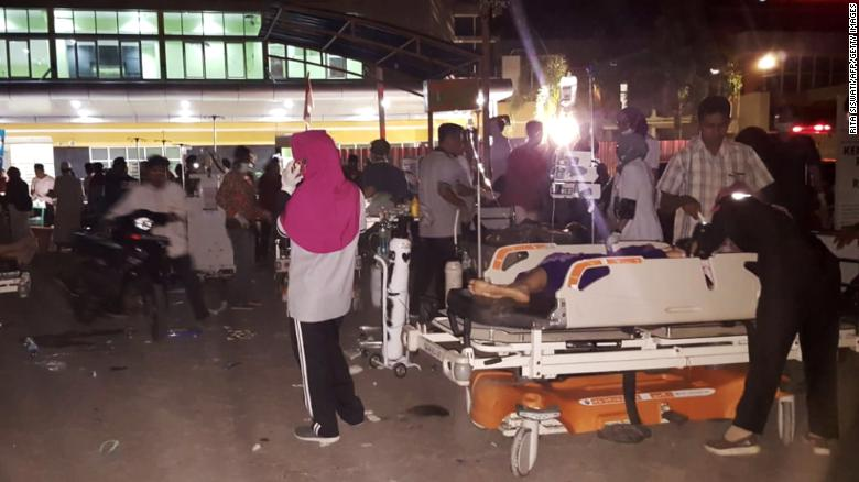 Medical staff treat patients outside a hospital on Lombok Island after an earthquake rocked Indonesia on Sunday.