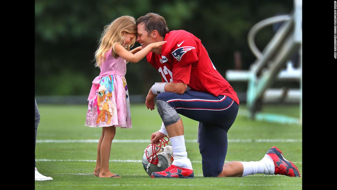 New England Patriots quarterback Tom Brady spends some time with his daughter, Vivian, 5, after Patriots training camp at the practice facility in Foxborough, Massachusetts on Wednesday, August 1.