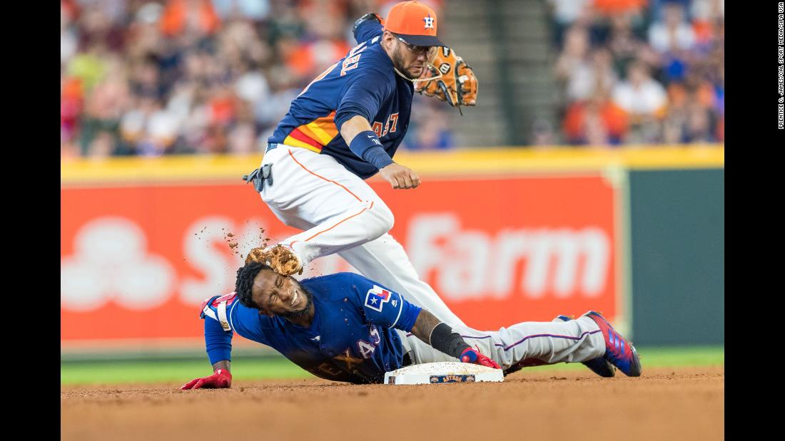 Texas Rangers shortstop Jurickson Profar is accidentally spiked in the face by Houston Astros second baseman Yuli Gurriel in the top of the sixth inning during a game between the Texas Rangers and the Houston Astros in Houston, Texas on Sunday, July 29.