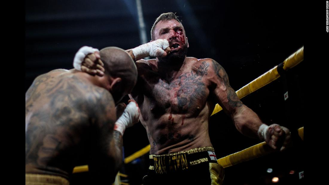 Two-time World Bare-Knuckle Boxing Champion Luke Atkin is hit by Dom Clark during the Rogue Elite world title main event at an Ultimate Bare Knuckle Boxing fight, at Bowlers Exhibition Centre on Saturday, August 4, in Manchester, England.