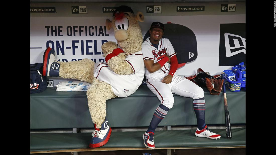 Atlanta Braves mascot Blooper and left fielder Ronald Acuna Jr. play around in the dugout during a rain delay before the game against the Miami Marlins on Tuesday, July 31, in Atlanta, Georgia.