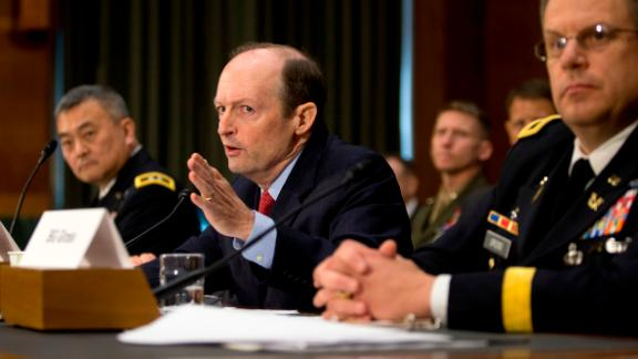 Assistant Defense Secretary for Special Operations Low-Intensity Conflict Michael Sheehan, center, testifies on Capitol Hill in Washington, Thursday, May 16, 2013, before the Senate Armed Services Committee hearing on law of armed conflict, the use of military force, and the 2001 Authorization for Use of Military Force. From left are, Major Gen. Michael Nagata, Deputy Director for Special Operations Counterterrorism, Sheehan and Brigadier Gen. Richard Gross, JAGC, USA, Legal Counsel, Chairman of the Joint Chiefs of Staff. (AP Photo/Carolyn Kaster)