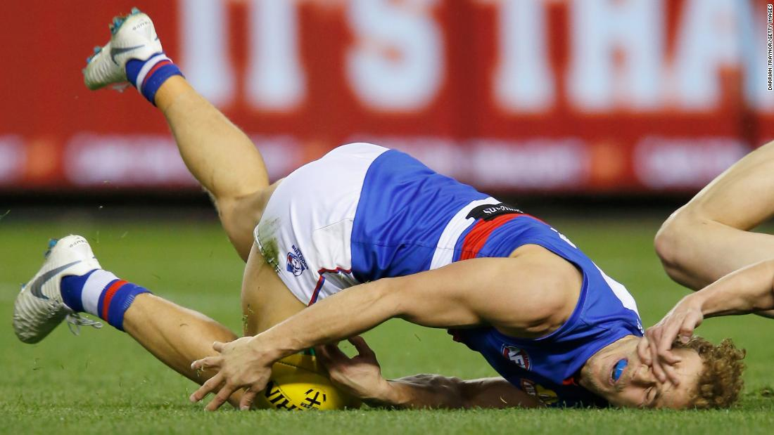 Jimmy Webster of the Saints tackles Mitch Wallis of the Bulldogs high during the round 20 AFL match between the St. Kilda Saints and the Western Bulldogs on Saturday, August 4, in Melbourne, Australia.