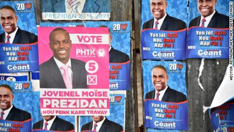Election posters of the presidential candidates Jovenel Moise of PHTK party and Jean Henry Céant are seen in a street in Port-au-Prince, Haiti on October 20, 2015. The next presidential elections will be held on October 25. AFP PHOTO/ HECTOR RETAMAL        (Photo credit should read HECTOR RETAMAL/AFP/Getty Images)