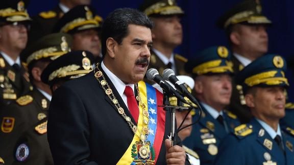 President Nicolas Maduro was delivering a speech when the explosions erupted.