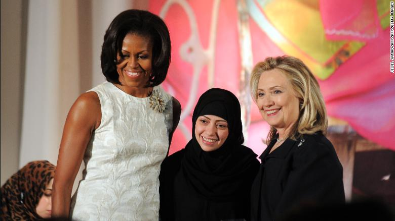 Michelle Obama and Hillary Clinton pose with Samar Badawi as she receives the 2012 International Women of Courage Award.