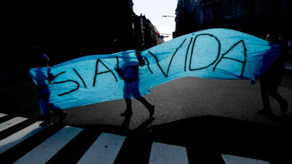 """Anti-abortion activists carry a """"Yes To Life"""" banner during a protest in Buenos Aires."""