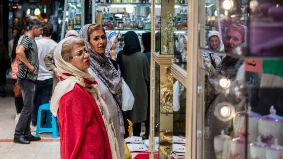 Customers browse goods on display in a store window inside the Grand Bazaar in Tehran, Iran, on Monday, Aug. 6, 2018. Irans central bank, acting on the eve of U.S. sanctions, scrapped most currency controls introduced this year in a bid to halt a plunge in the rial that has stirred protests against the government of PresidentHassan Rouhani. Photographer: Ali Mohammadi/Bloomberg via Getty Imagesrg